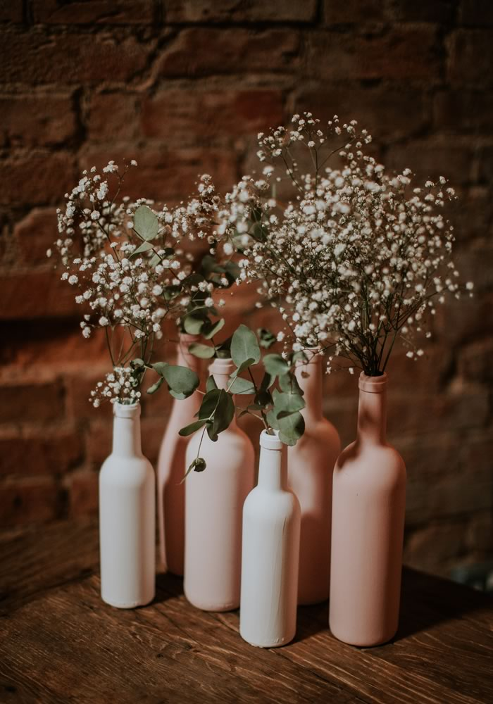 pastel vase bottles- Barn Wedding Decor and how to Style It
