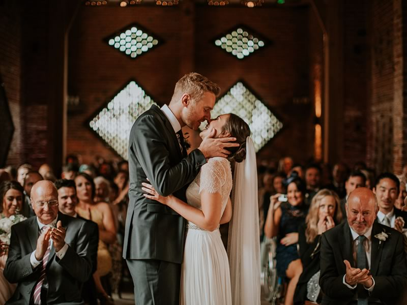 kissing couple Barn Wedding Decor and how to Style It