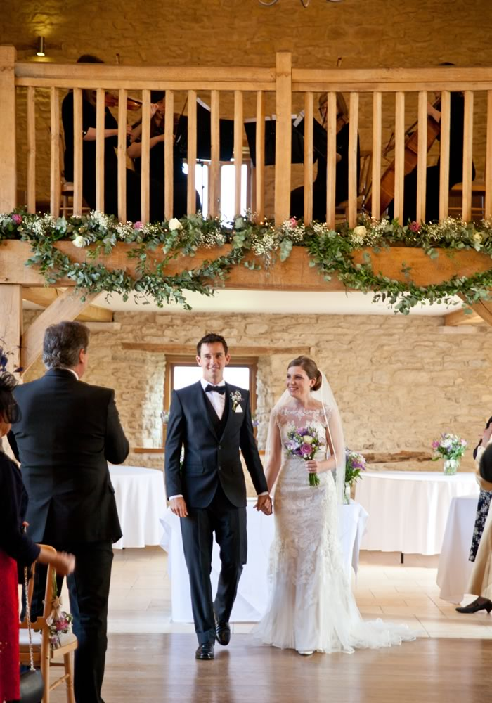 just married couple walking- Barn Wedding Decor and how to Style It