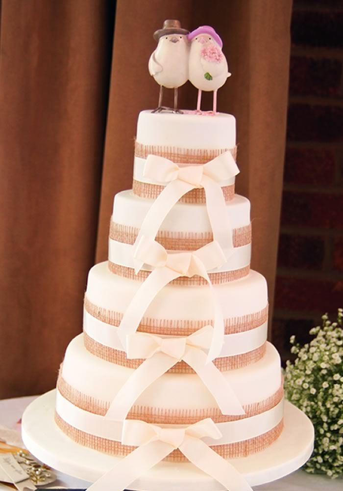 Save money on your wedding and DIY your cake, whether you buy luxury iced tiers from M&S or bake your own, here's how to decorate your wedding cake