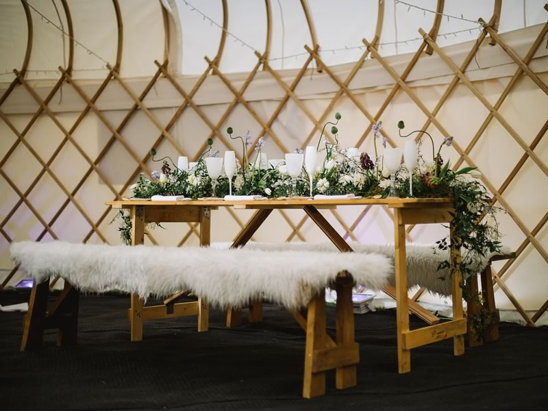 Sumptuous faux furs meet the aged charm of real wood, reclaimed vases, tables and decorative pieces in the prettiest rustic luxe wedding reception theme