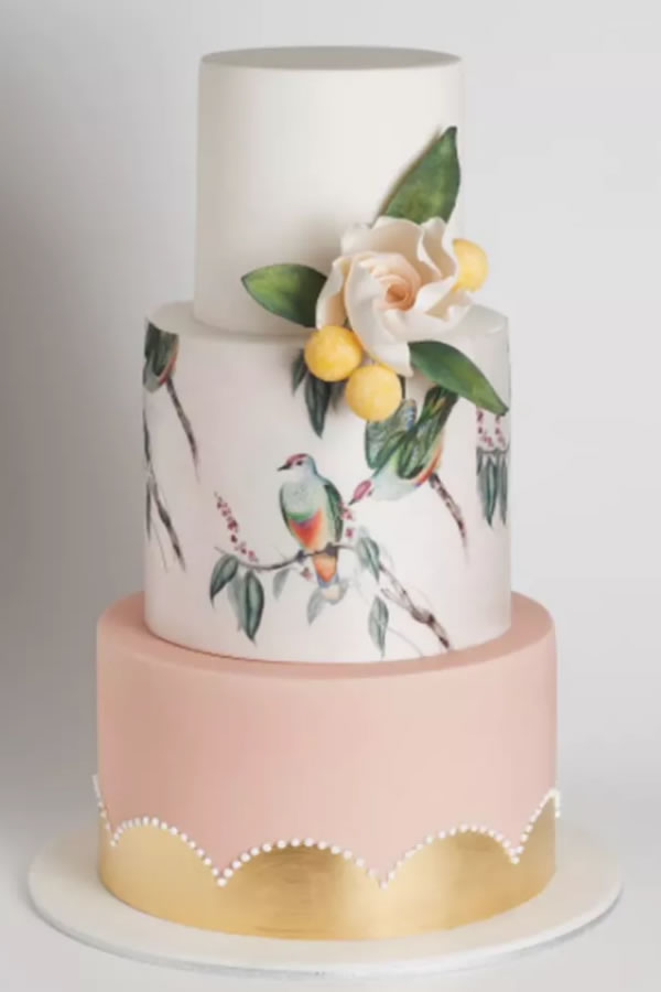 Cake_Ink/Instagram: Tropical meets pastel for a Springtime paradise with block colour fondant icing and painted wash effect birds.