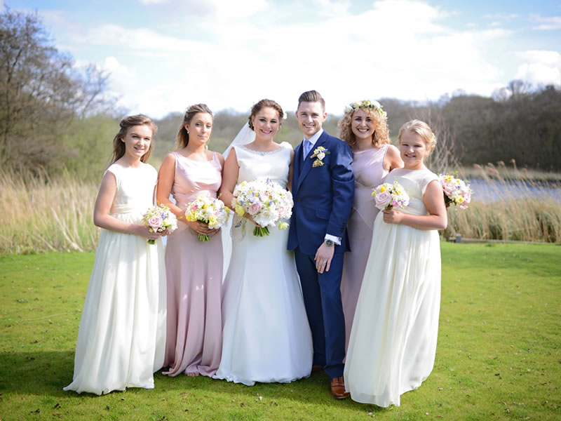 This bride has long awaited to wed outside by the waterside under a beautiful blossom tree which provided the pretty pastel Springtime colours to her theme