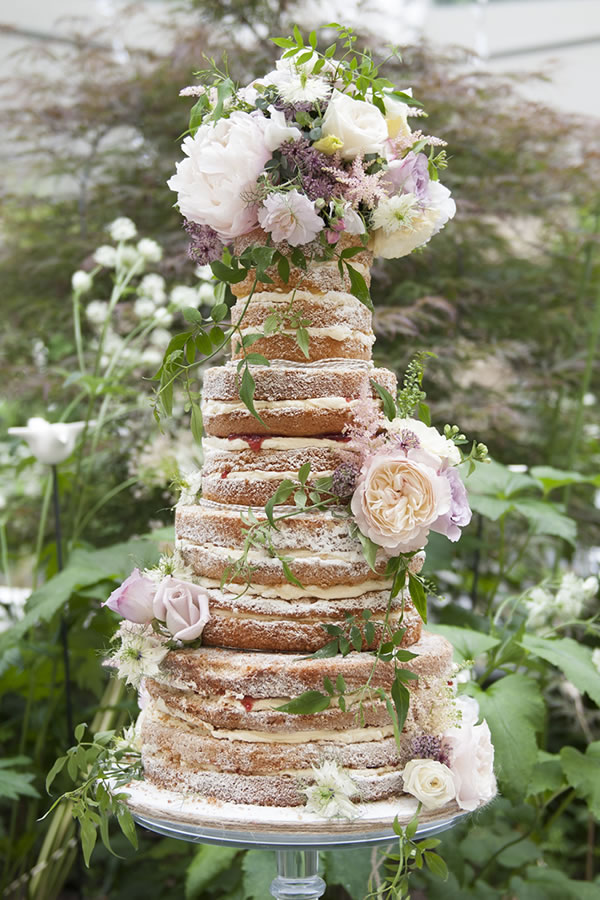 edibleessencecakeart.com: Did we hear you say rustic wedding? The ultimate naked cake masterpiece adorned with fluffy blooms