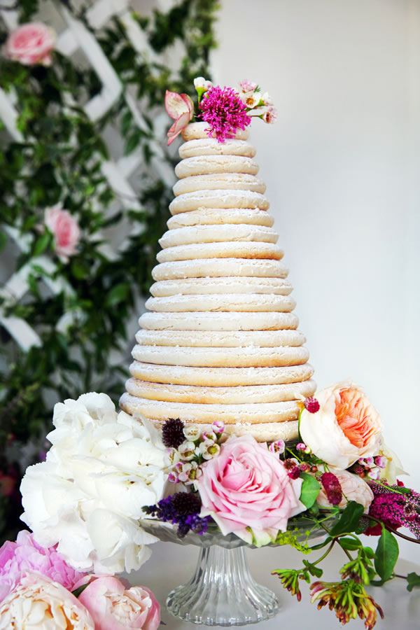 edibleessencecakeart.com: Traditional + delicate Danish Kransekage, made entirely from stacked marzipan rings