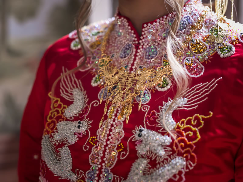 Two ceremonies bring together East and West with one in Italy and a traditional Chinese wedding in a nod to Kei's heritage!