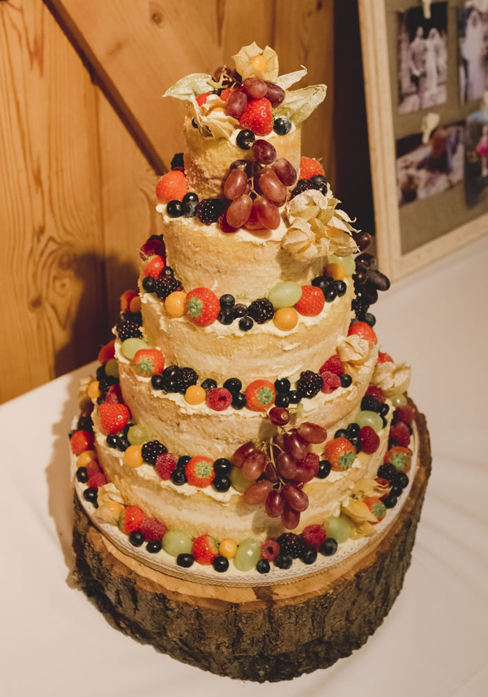An array of bold oranges and reds evoked this bountiful season to compliment this couple's country themed barn wedding!