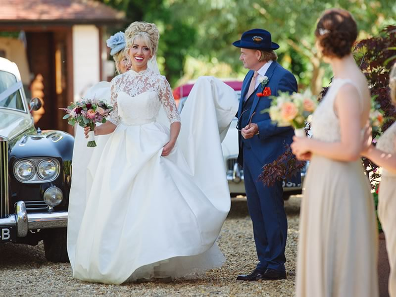 Serena and Jordan celebrated in a fairytale day of deep red, champagne gold and ivory, tying the knot right on the water's edge at Sheene Mill...