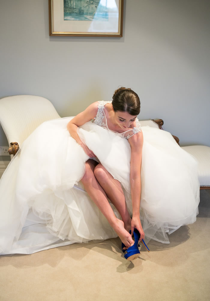 Royal blue wedding details and a dress the bride thought she would hate...until she tried it on! What this bride proved about wedding dress shopping...
