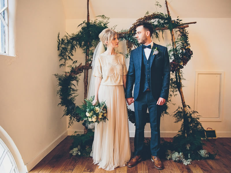 A proposal in New Zealand transformed into an understated and totally on-trend day filled with cool blues, a lightbulb ceiling and ferns galore!