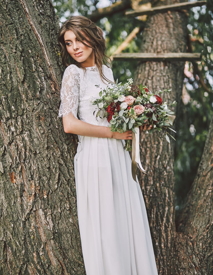 Think romantic tousled curls and tendrils to compliment a chic boho beach gown and ceremony with flowing fabrics, bouquet ribbons and feminine lacy details.