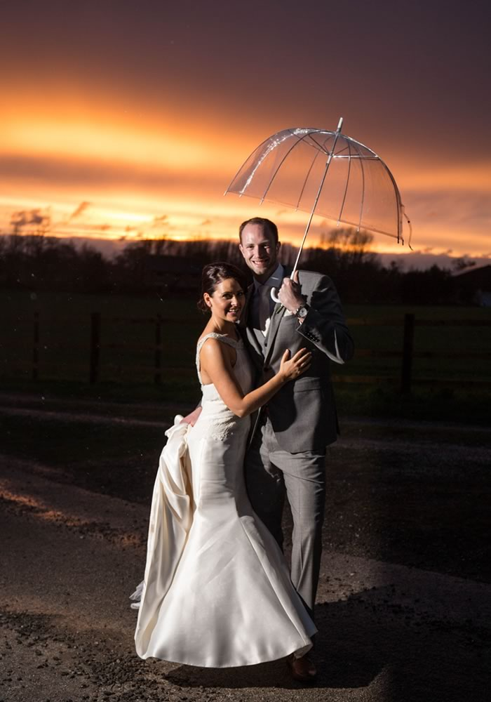 While Amanda and Jack booked an Easter weekend wedding, the sun gave way to rain. Despite the downpour, their pink wedding was perfect with stunning photos