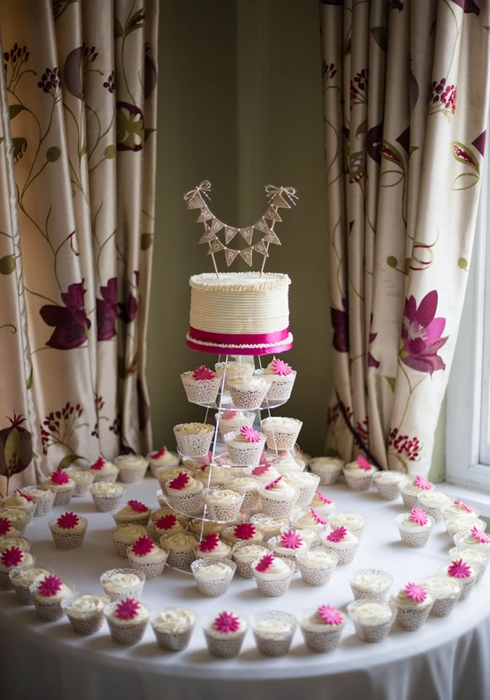 A Shropshire wedding full of cerise pink flowers and decorations for Sue and Craig. Plus a best man's speech that will melt your heart!