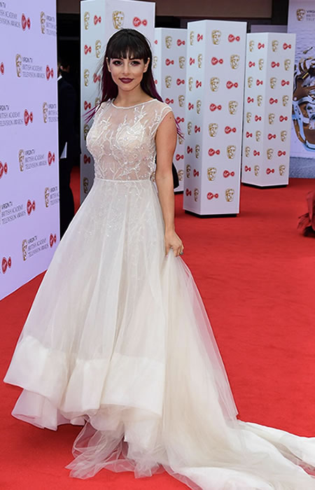 TV and west End Star Roxanne Pallett made a statement in a embellished bodice Berta dress with open back detail and train.