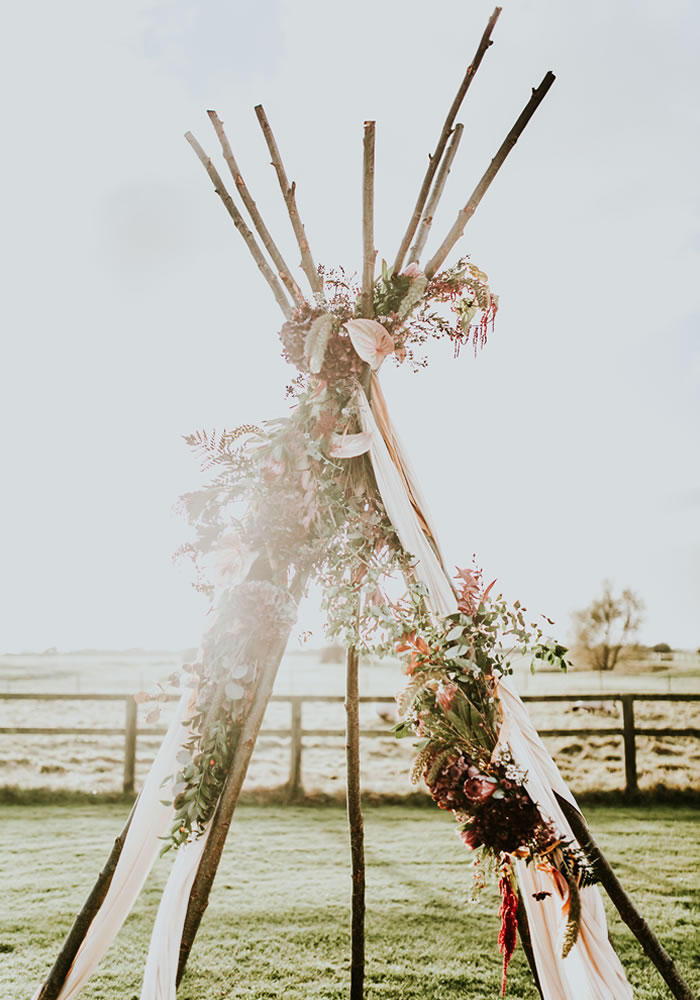 Wild flowers and rolling countryside - there's something hopelessly romantic and fairytale-esque about getting hitched in the great outdoors?!