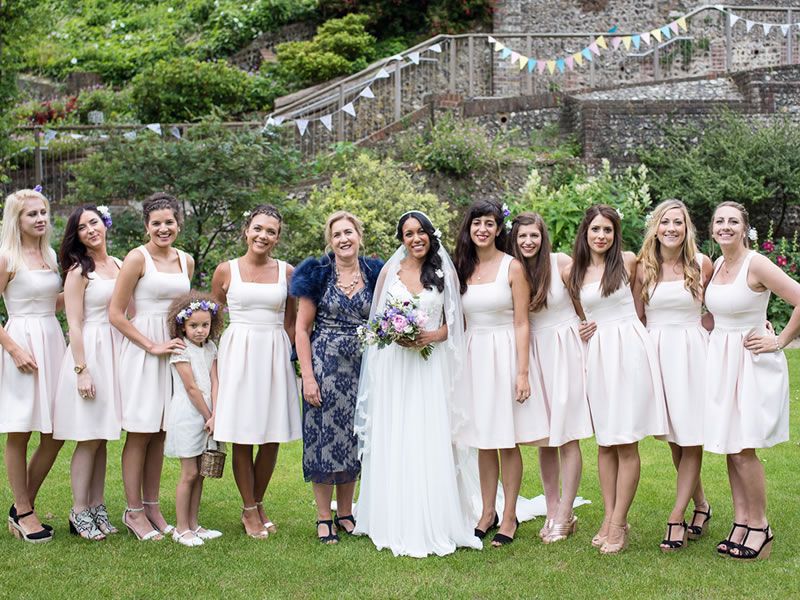 A fairytale feel summer wedding with elegant sparkly details and lots of hand made decor for this happy bride and her team of bridesmaids, a vision in white