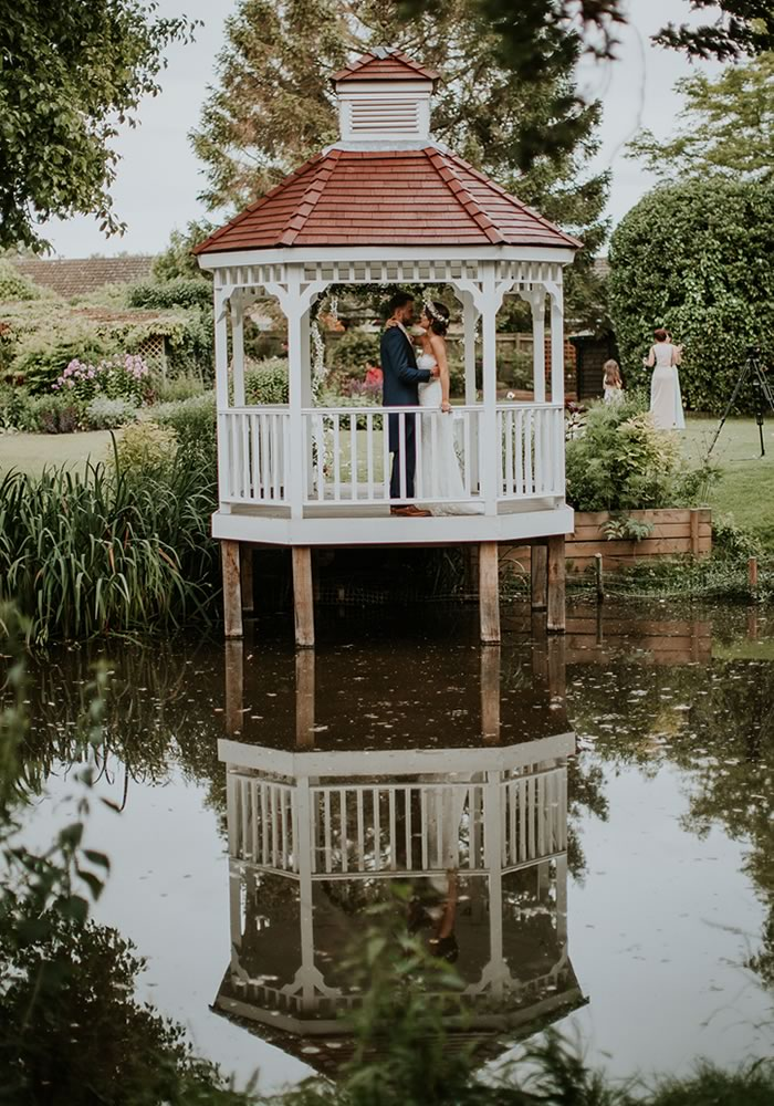 Be inspired for your own outdoor ceremony or lake wedding by Harriet and Simon's fairytale wedding, complete with floral arches and stunning photographs...