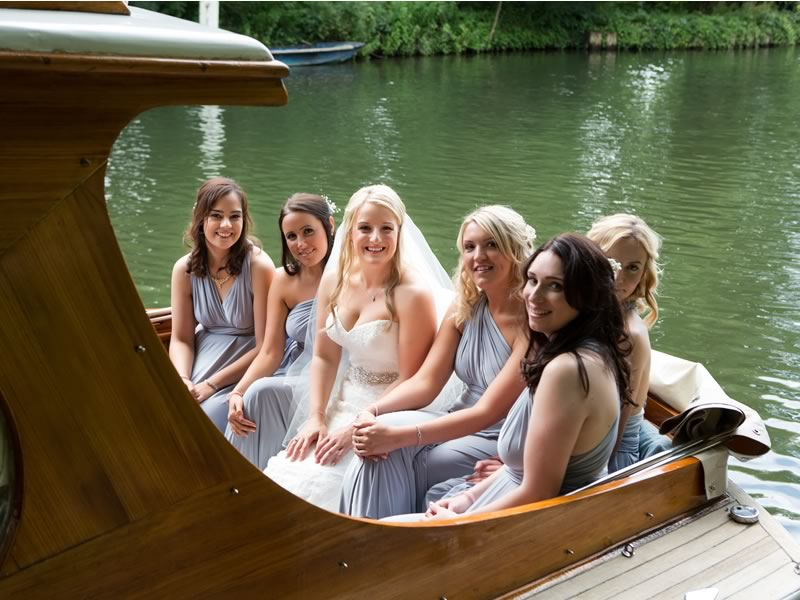 Victoria and Tom also exchanged vows on the riverside, surprised their guests with a river cruise AND nailed a vintage travel theme for their Thames wedding