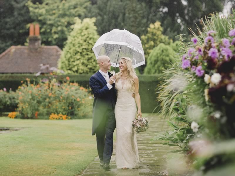 Rain on your wedding day won't be the end of the world and Kelly and Sean are here to prove it. Fall for their gorgeous woodland wedding and amazing photos!