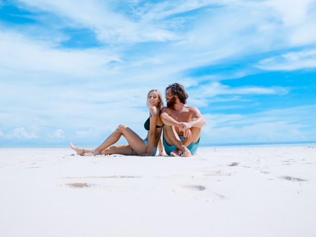 Couple on beach - 6 Money-Saving Tips for Planning Your Honeymoon