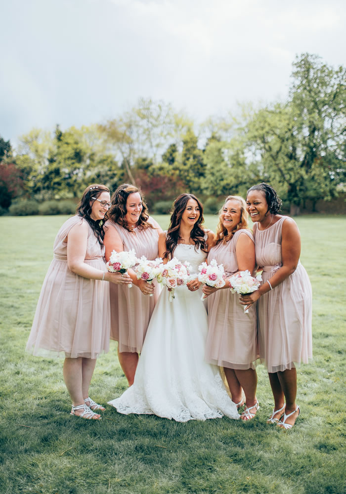 A soft palette of dreamy pinks inspired this couple's pastel theme with rosy colours for the bridesmaids and striking white and pink rose flower bouquets!