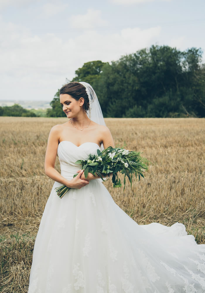 Steph's beautiful 'Rosabella' dress from Burr bridal provided all the inspiration to hold an Italian style reception inside the English Country barn venue