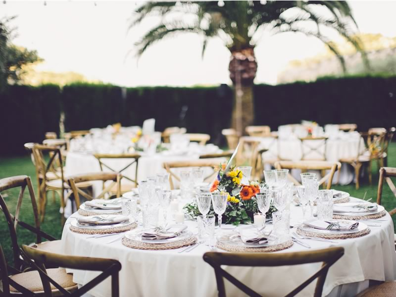 This destination wedding in Mallorca captures the laid-back, al fresco magic of the Mediterranean. Simply chic olive sprigs and succulents add style...