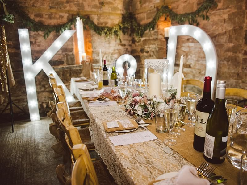 This rustic barn wedding had a brilliantly atmospheric style thanks to glittering gold accents, warm lighting and hessian and lace details...
