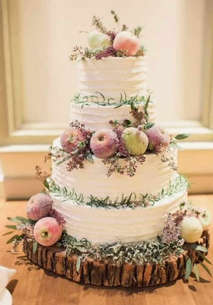 Cream buttercream wedding cake with apples
