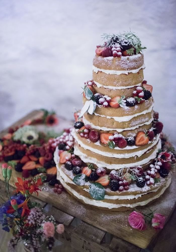 Naked cake with buttercream and red berries