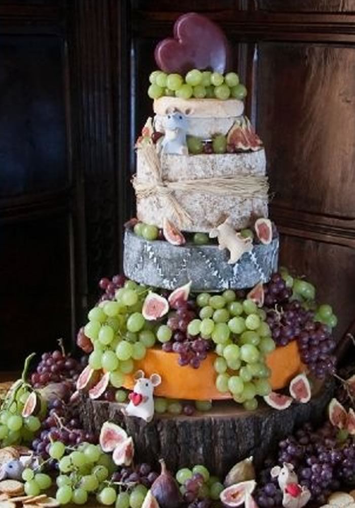 Cheese wedding cake with grapes and figs