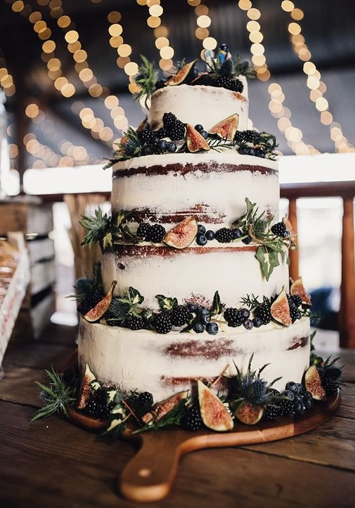 Cream buttercream wedding cake with blackberries and figs