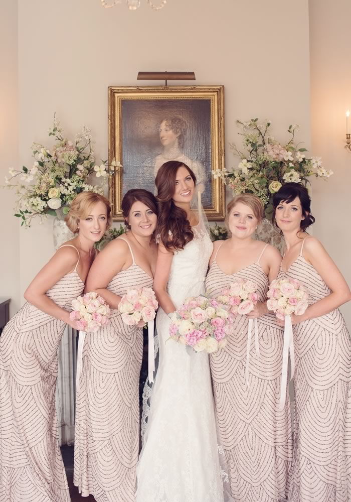 Planning your own pink and gold wedding? Then you'll LOVE this real wedding, featuring blossom trees, sequin table runners and show-stopping centrepieces.