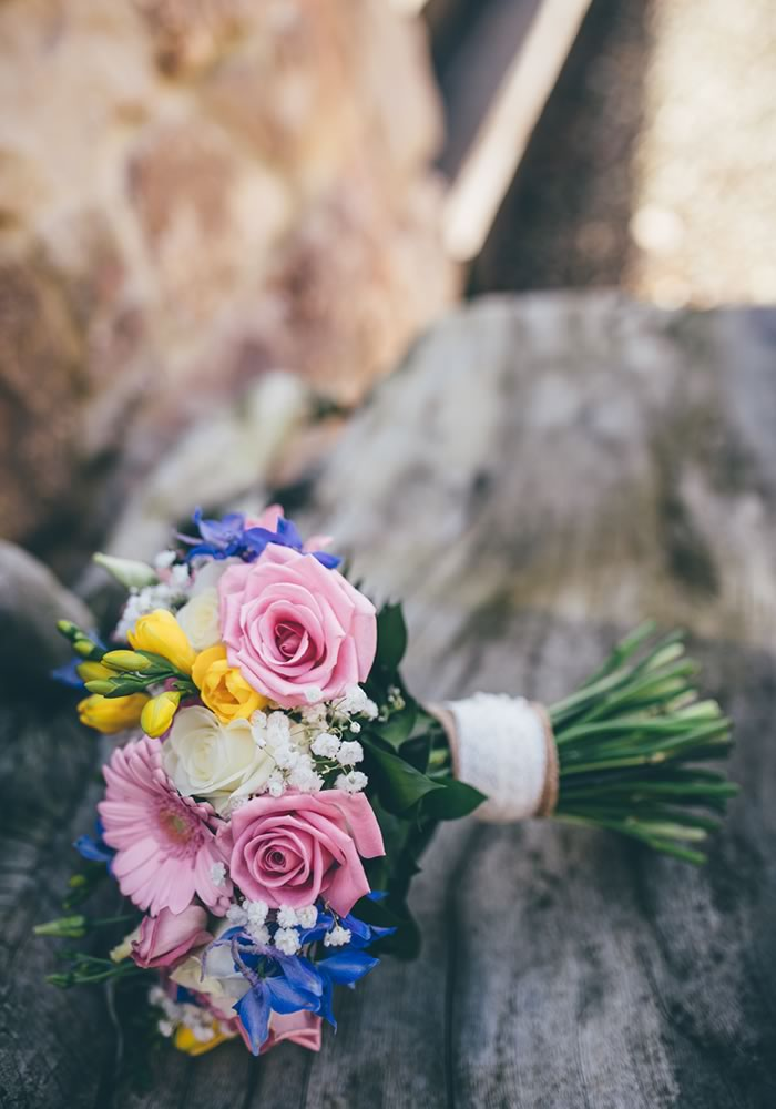 This Welsh beach wedding at Oxwich Bay is full of fun and colourful details for a couple who's love for surfing was what first brought them together...