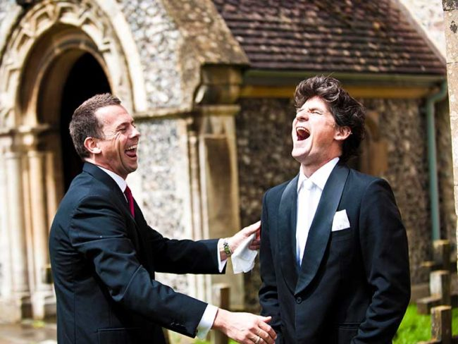 laughing groom and best man  choosing the right wedding photographer