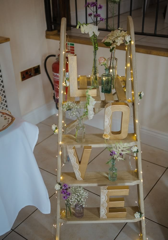 A rustic and rural Devon wedding venue filled with vintage, upcycled and shabby chic decorations creates this gorgeous take on a vintage wedding theme