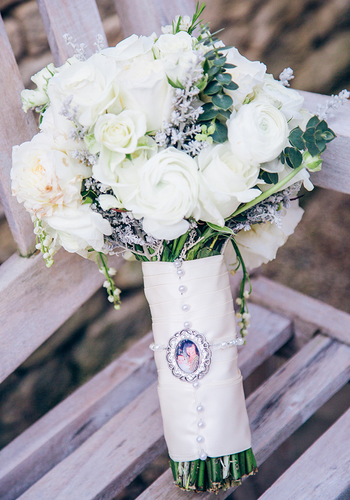 This floral wedding will put a spring in your step, featuring pretty pastel country flowers, a beautiful barn venue and stunning fairy light chandelier!