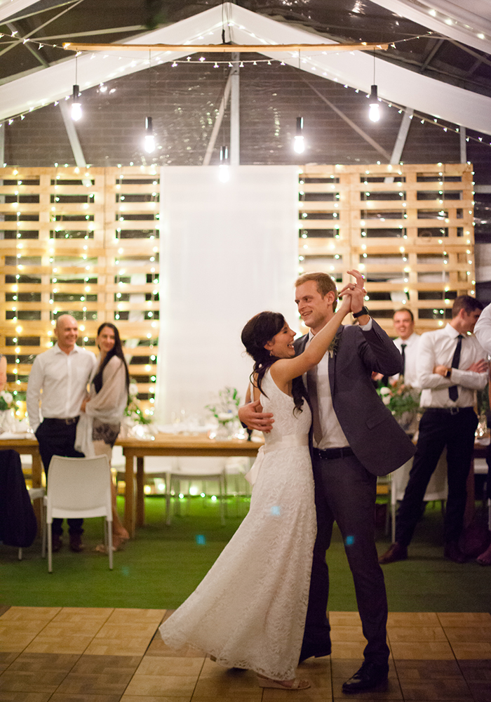 Hanging greenery chandeliers, trestle tables on the rooftop and stunning South African sea views... what's not to love about this rustic wedding in the city