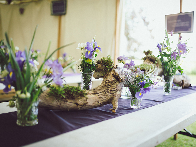 This purple wedding takes homemade and DIY to a whole new level, with family and friends catering, making the cake and even building the tipi!