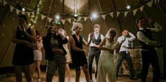 25 Perfect Wedding Reception Songs Guaranteed to Fill Your Dancefloor