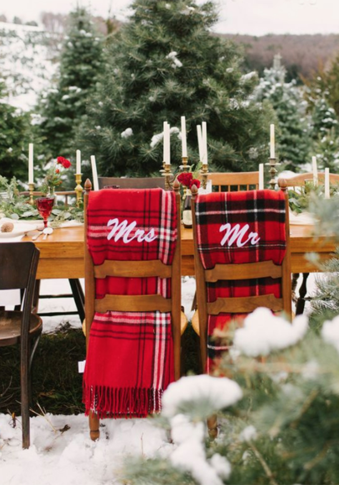 Snowy outdoor Christmas table setting with personalised tartan throws