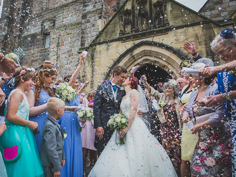 This couple's colourful church wedding had lots of handmade touches, beautiful birdcage centrepieces and a super fun party. See for yourself...