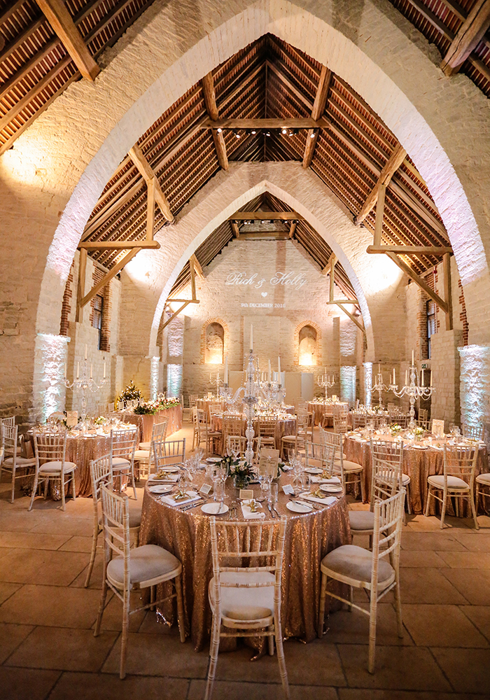 Holly and Richard married in Hampshire barn over the festive period, making the most of it with a sparkling Christmas wedding theme and fairy lights...