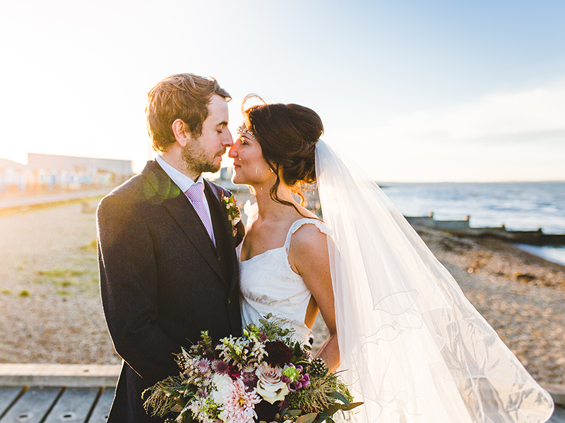 Love the idea of a seaside ceremony but worried about cold weather? Check out April and Sean's beach winter wedding, which was full of atmosphere, for ideas