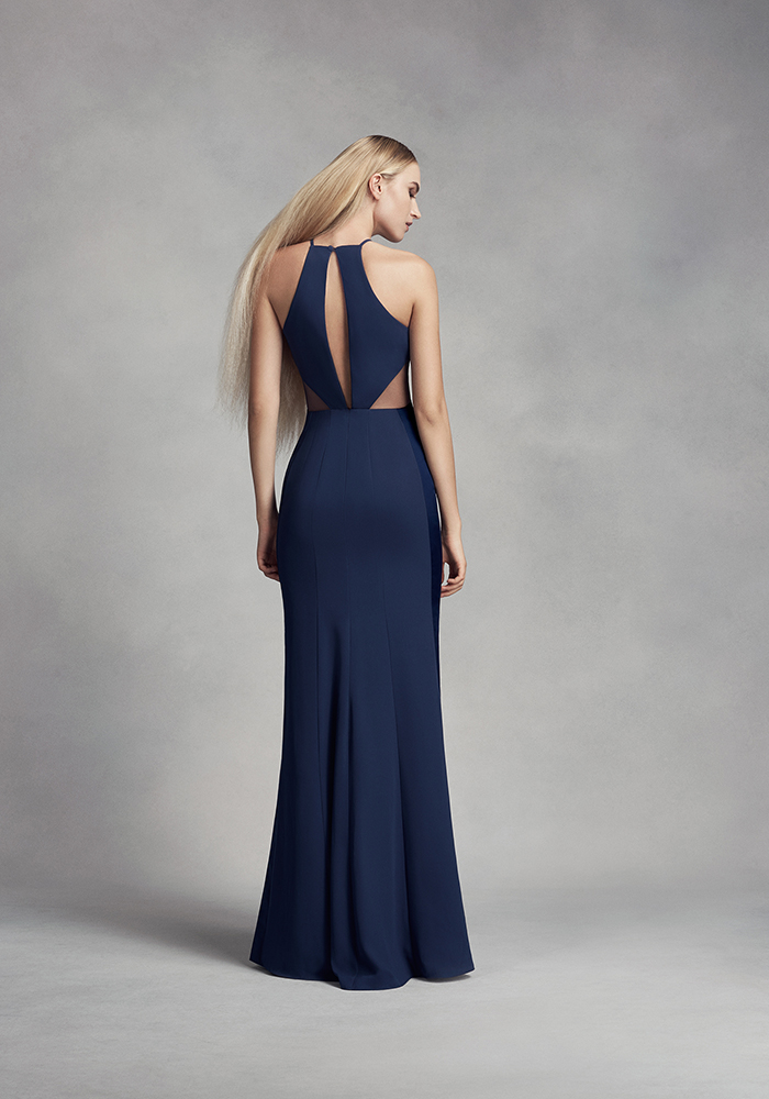 Please all of your girls with navy bridesmaid dresses in an elegant midnight blue hue, whether fitted and floor-length, mid-length or with a statement back