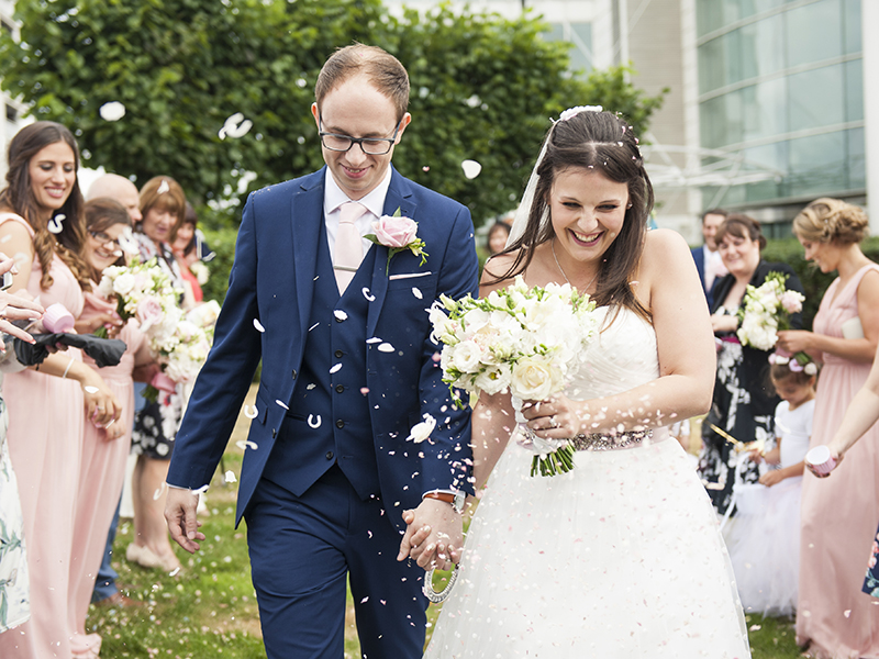 This funfair wedding in Cardiff Bay featured a blush and gold colour scheme, a beach setting and lots of surprises! See all the photos and find out more...