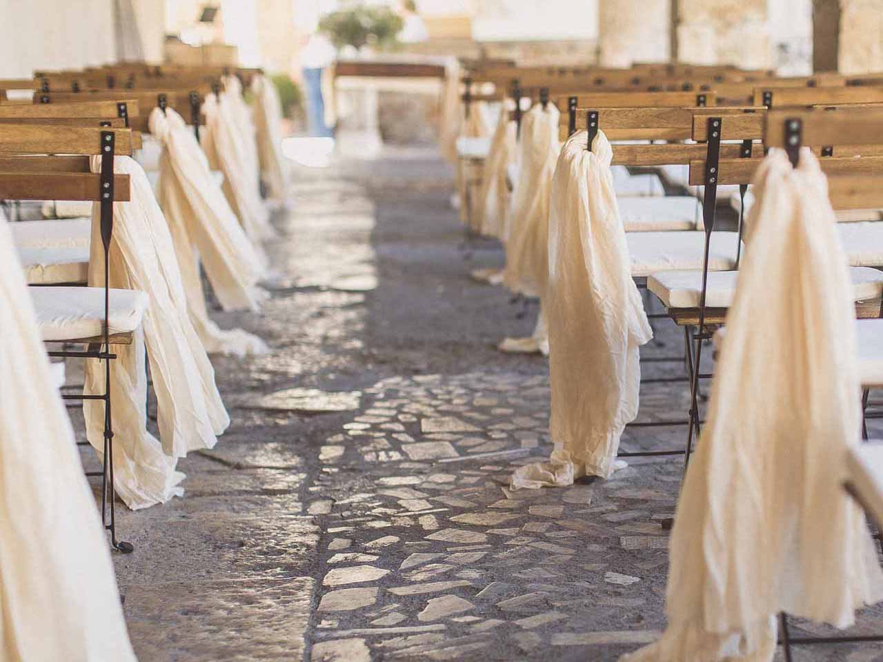 Cream table runners ceremony - credit wearetheclarkes photography