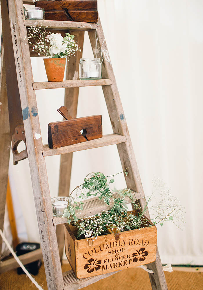 Amy and Edward married in a gorgeous rustic marquee wedding, featuring handmade wooden tables, food that became entertainment and white and green flowers...