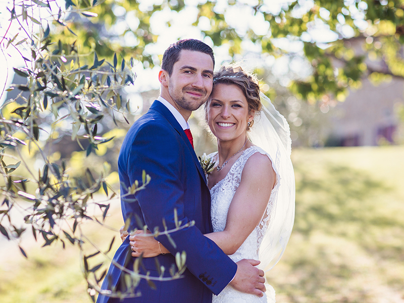 Planning your own wedding in Tuscany? Then you'll LOVE this rustic big day with an outdoor ceremony and castle reception. See all the photos here...