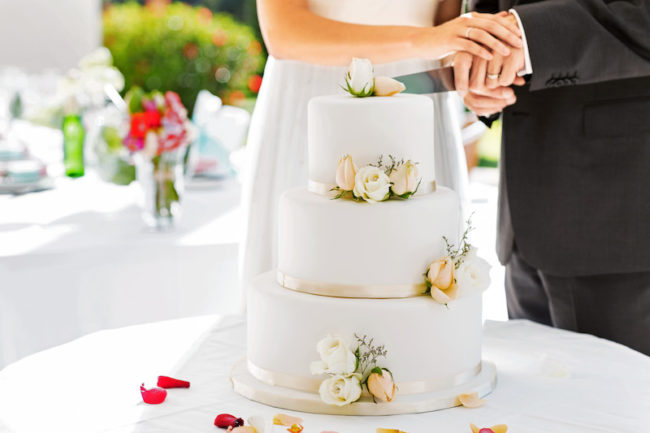 Bride and Groom Cutting Cake - Wedding Cake Tiers, Sizes and Servings: Everything You Need to Know